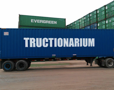 Container ship with the word Tructionarium written down the side
