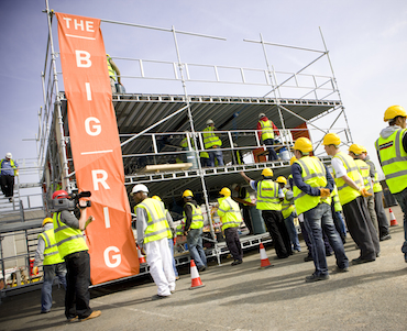 Image showing students working on the Big Rig, a pop-up education space created within a three-storey scaffolding frame