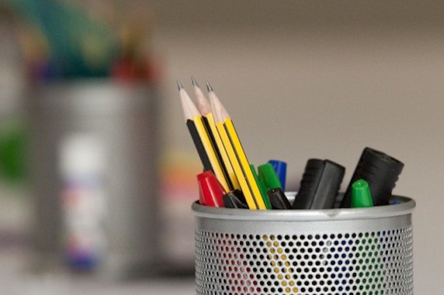 Image of a pot with pencils and highlighters